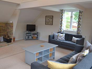 Little Dunley Holiday Cottages Devon - Vine lodge lounge