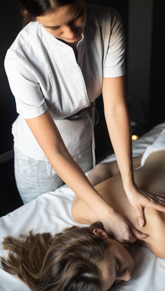 facilities- Young woman receiving a swedish massage - little dunley cottages